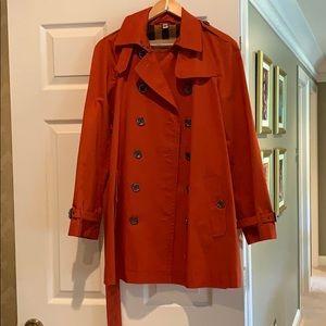 Burberry burnt orange rain coat